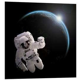 Tableau en PVC  Astronaut floating in space as the sun rises on to Earth-like planet. - Marc Ward