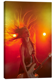 Tableau sur toile  Rock girl playing the electric guitar